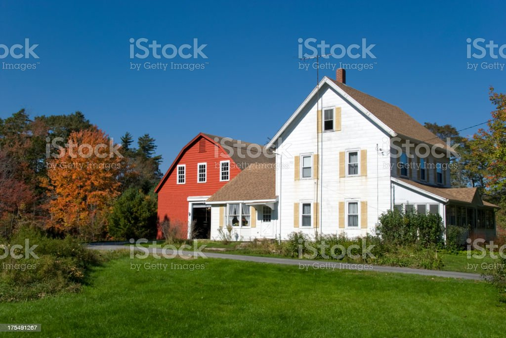 New England Farmhouse with red barn in autumn colors stock photo