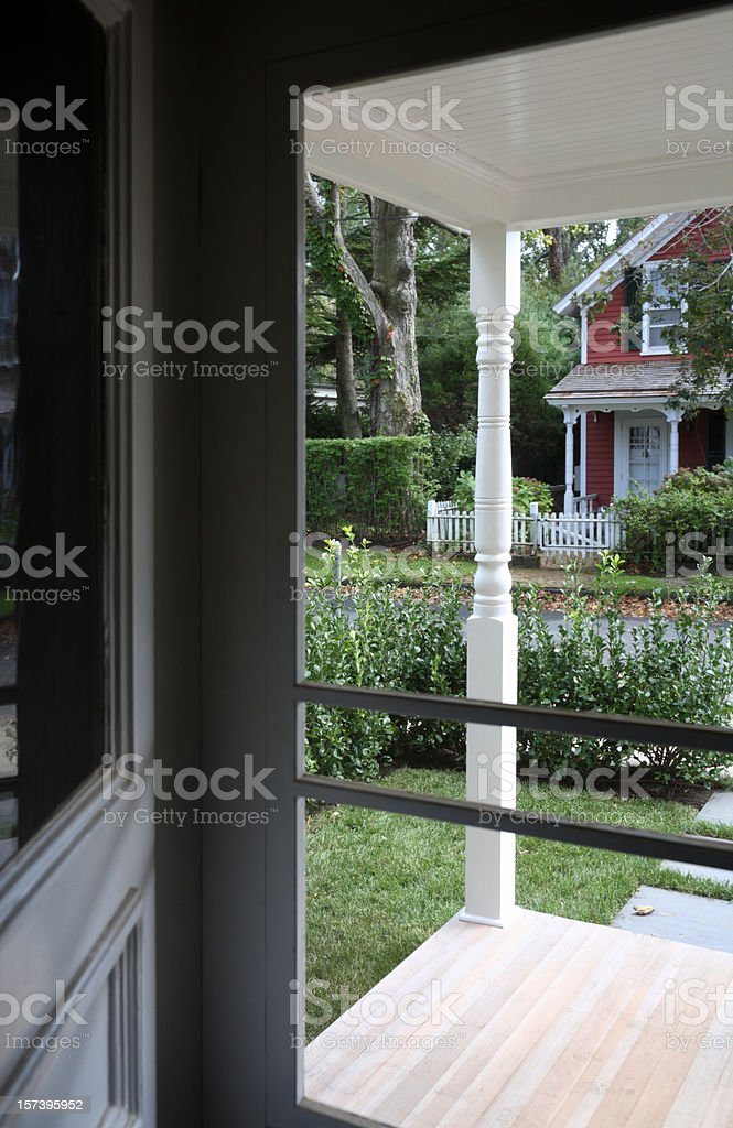 New England home through screen door stock photo
