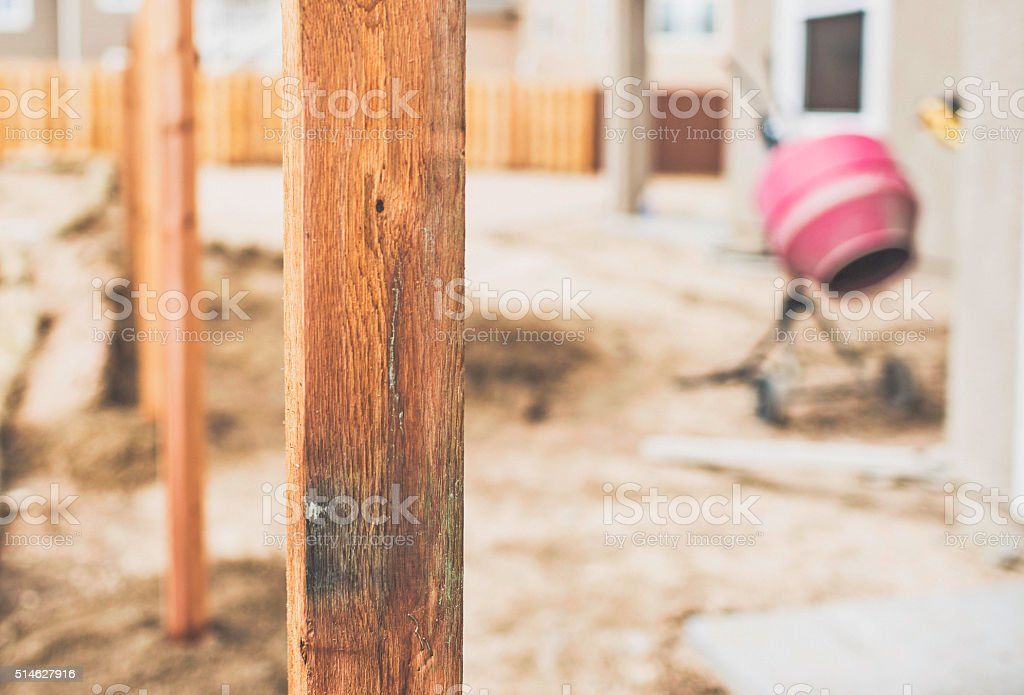 New fence construction. Fence posts cemented into ground stock photo