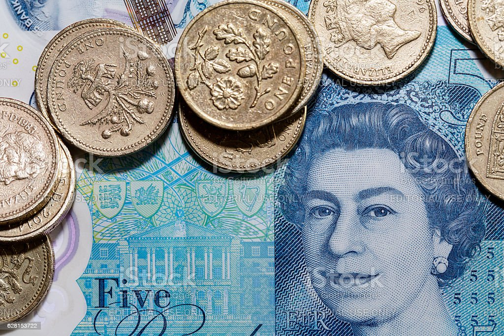 New Five Pound Note and One Pound Coins stock photo