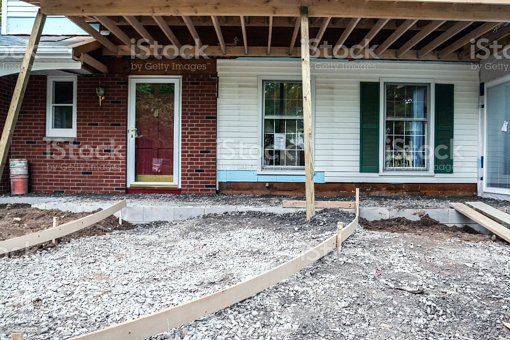 New Front Porch And Curved Walkway Ramp Wooden Construction Frame stock photo