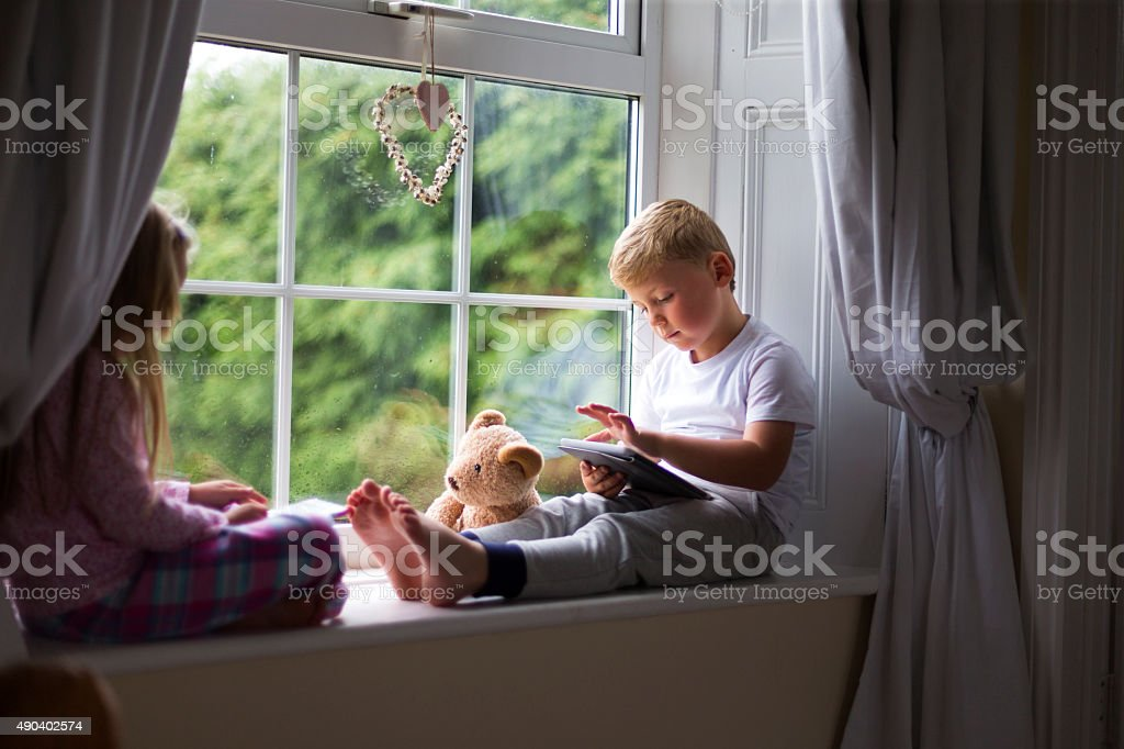 New generation up on their technology stock photo