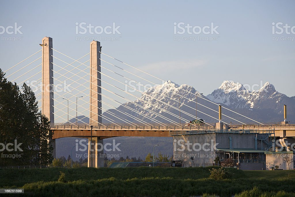 New Golden Ears Bridge With Snowcapped Mountains stock photo