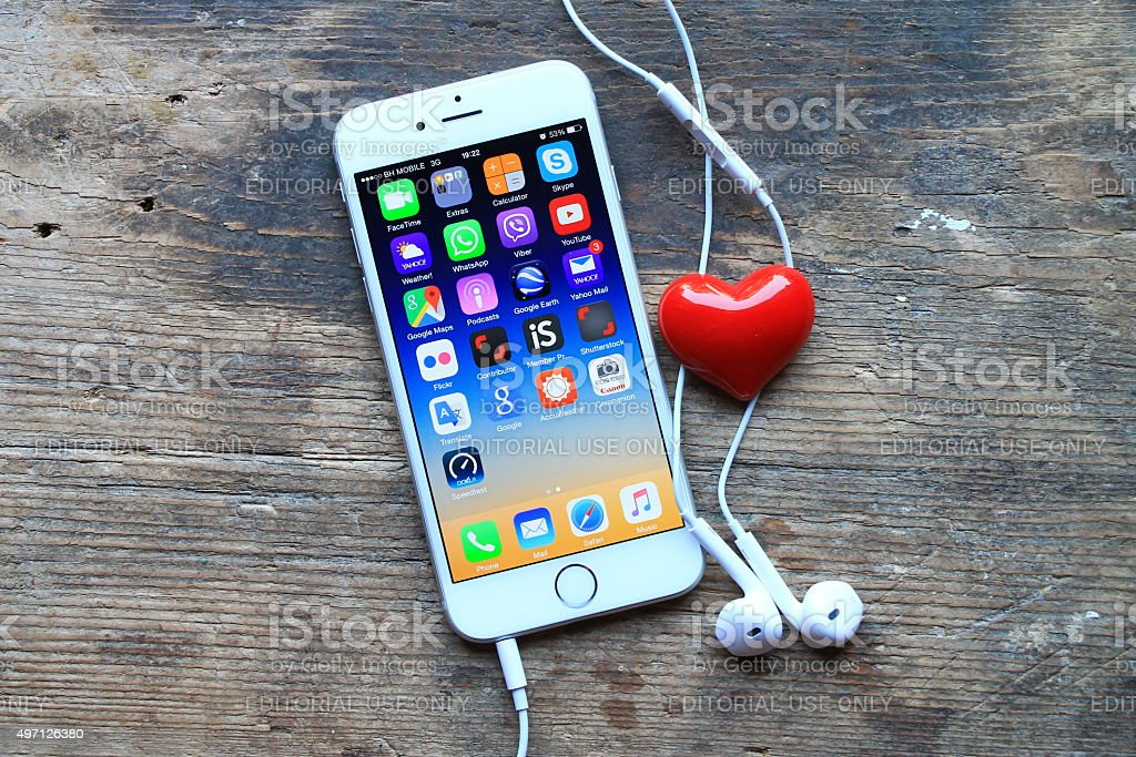New gray iphone 6 adn small red heart stock photo
