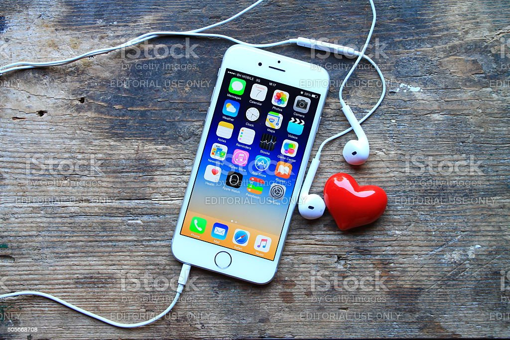 New gray iphone 6 and small red heart stock photo
