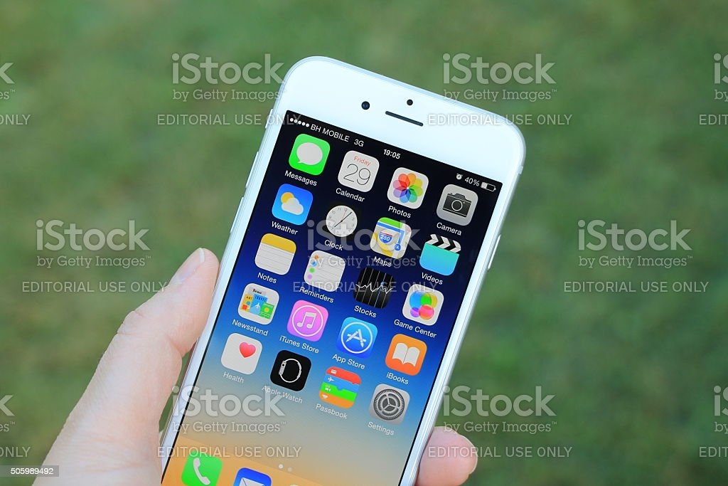 New gray iphone 6 in woman's hand stock photo
