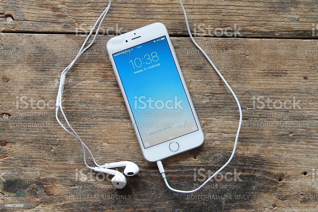 New gray iPhone 6 on the wooden table stock photo