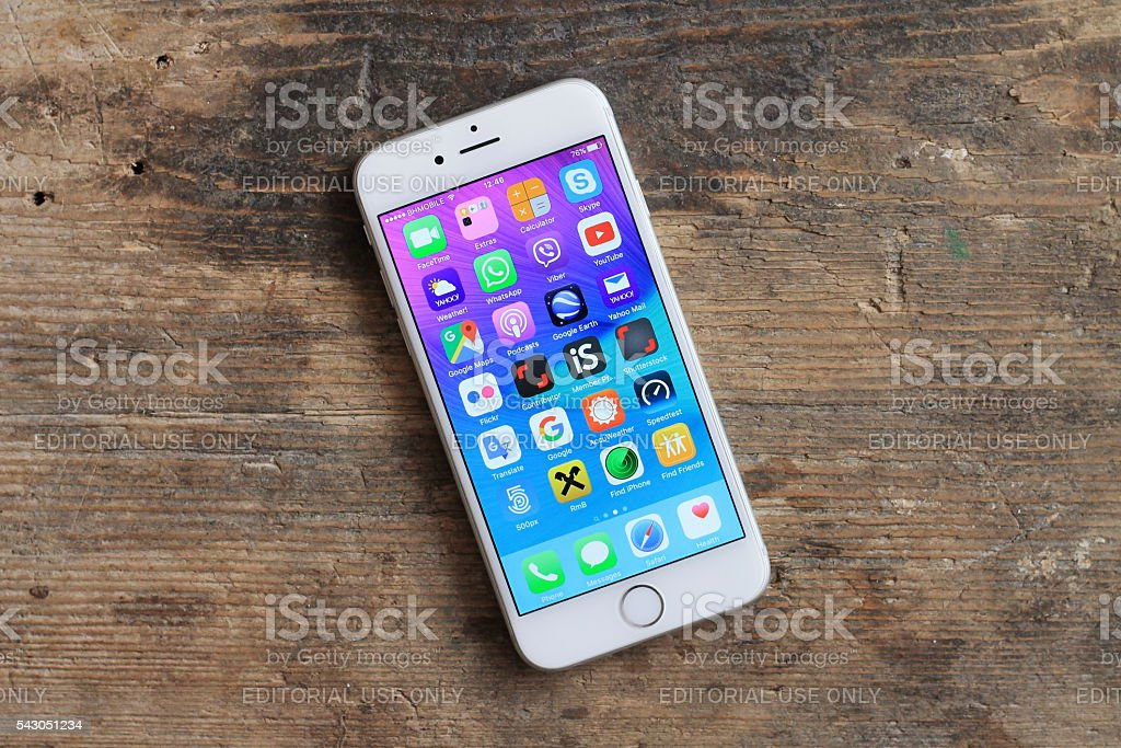 New gray iphone 6  on the wooden table. stock photo