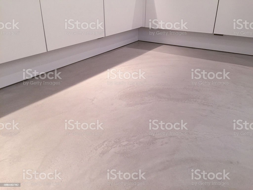 New grey cement floor in the kitchen stock photo