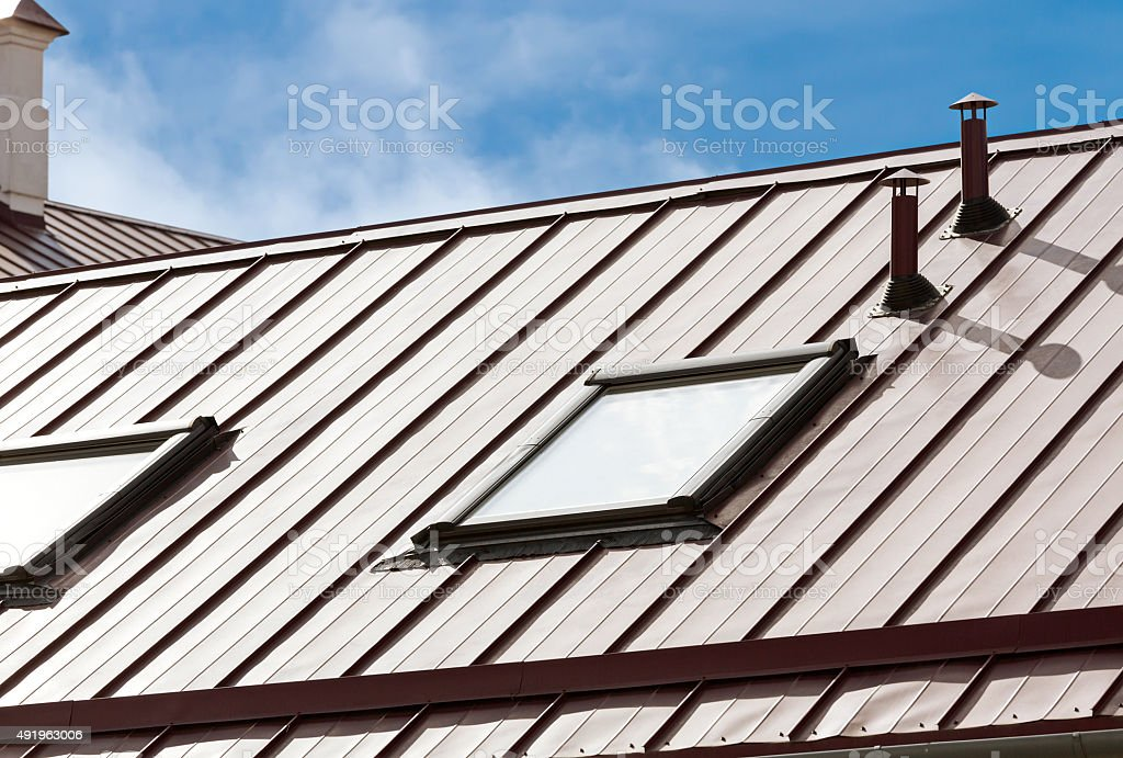 new grey roof with skylights stock photo