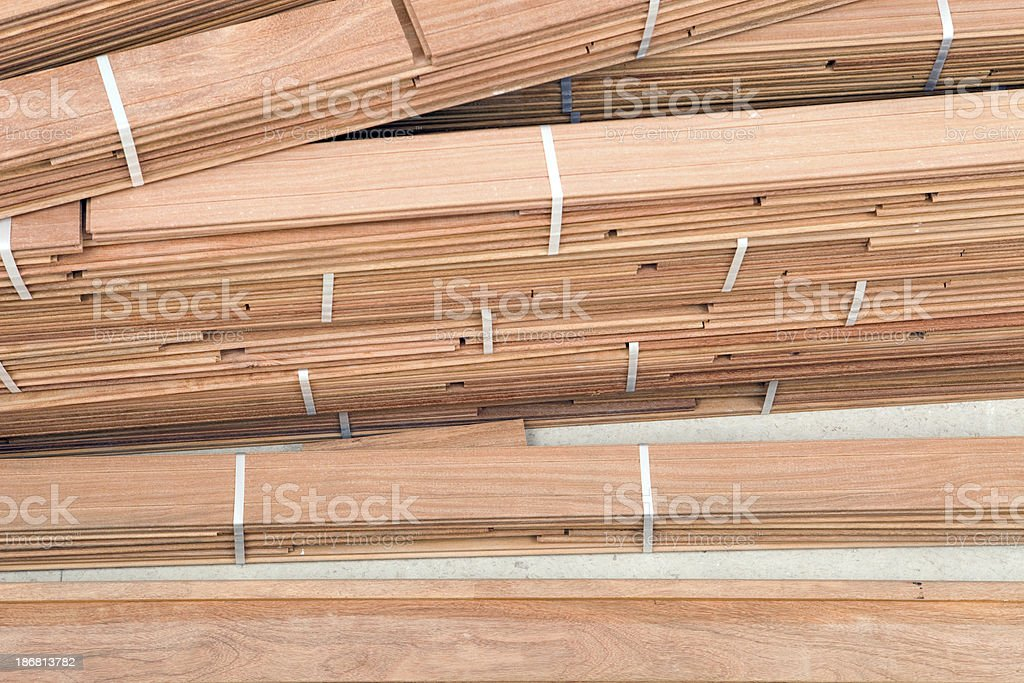 New Hardwood Floor Planks Stacked at a Construction Site stock photo