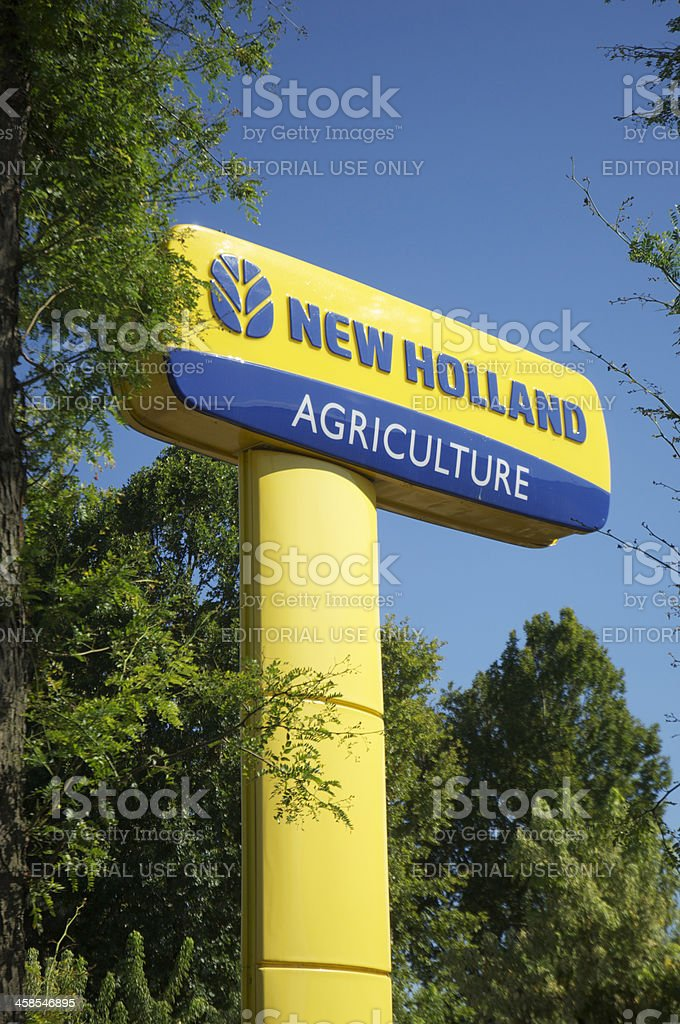 New Holland Agriculture sign against Blue sky stock photo