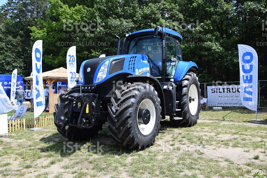 New Holland tractor on the motor show stock photo