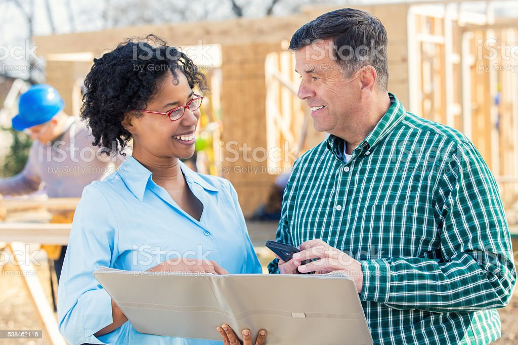 New home builders review plans stock photo