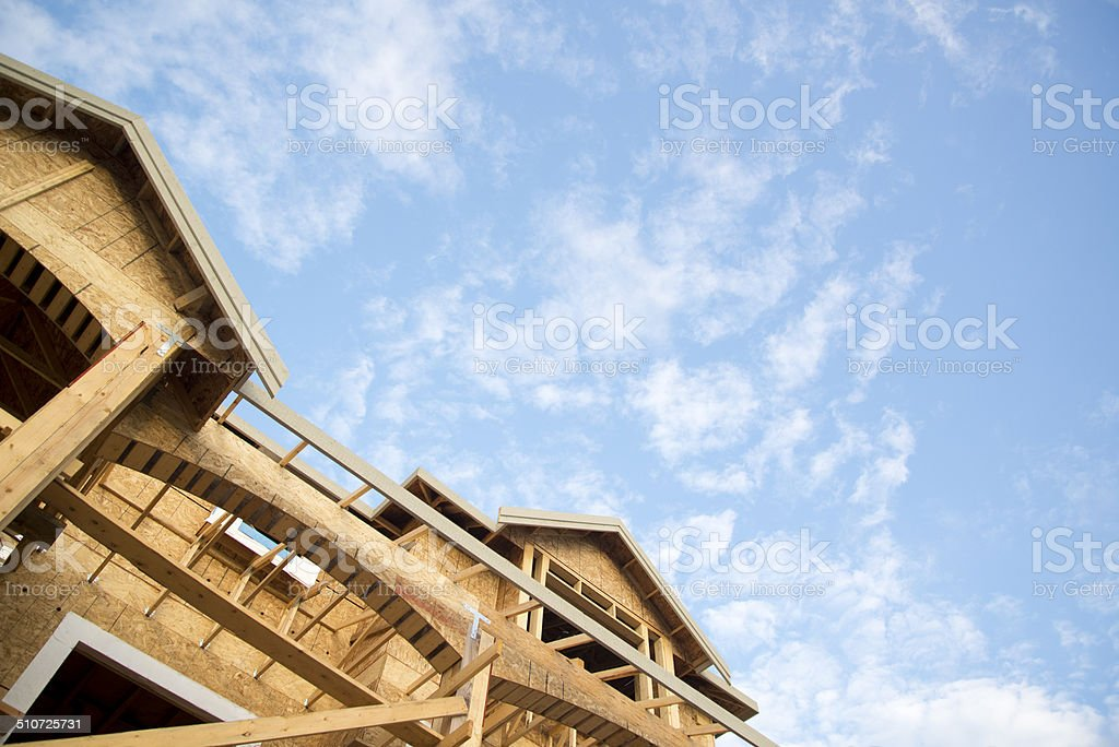 New home construction against blue sky stock photo