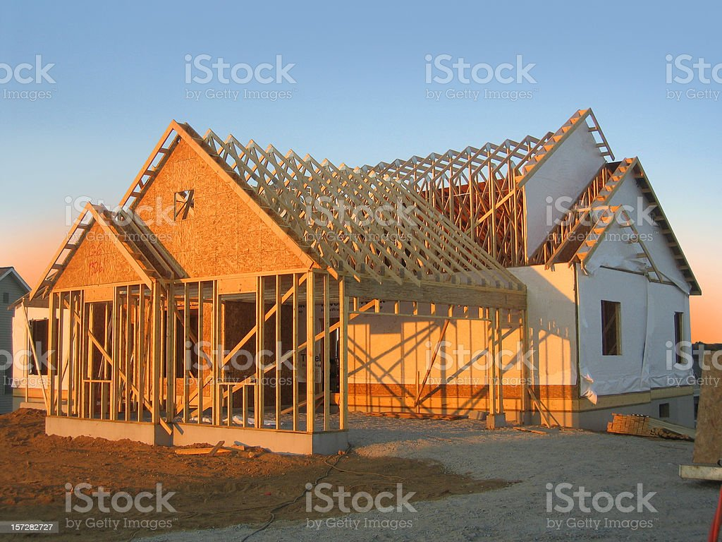 New Home Construction at Dusk stock photo