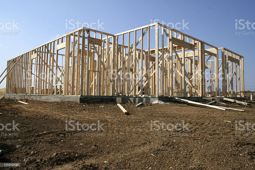 New Home Construction On Dirt Lot With Sky In Background stock photo