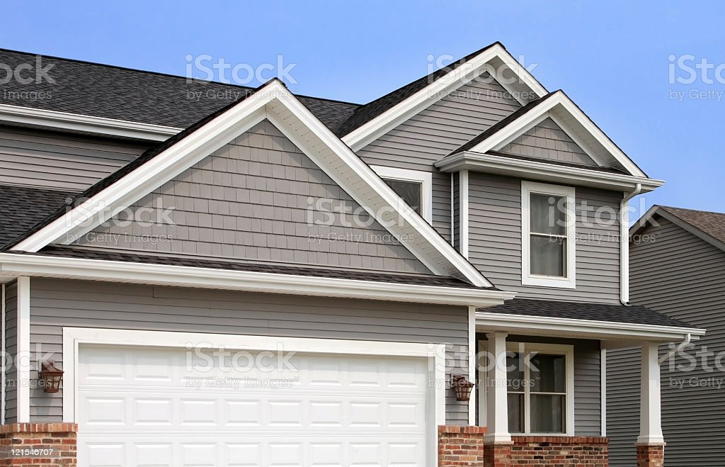 New home construction, showing siding, roofing, gutters, garage door