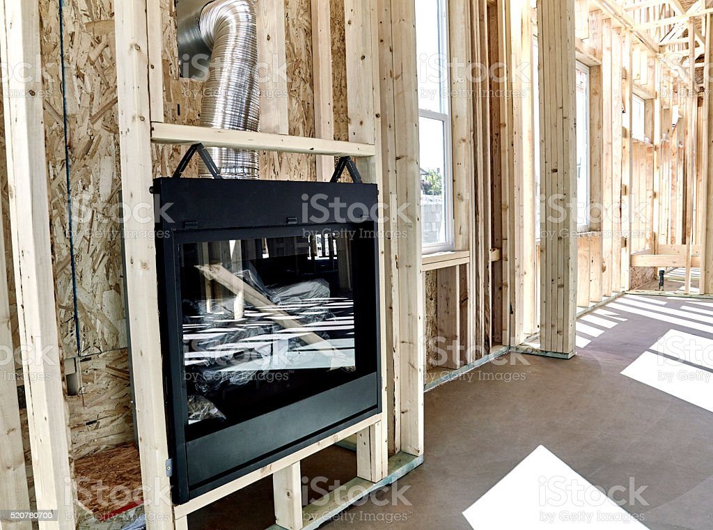 New Home Construction with Gas Fireplace Installed stock photo