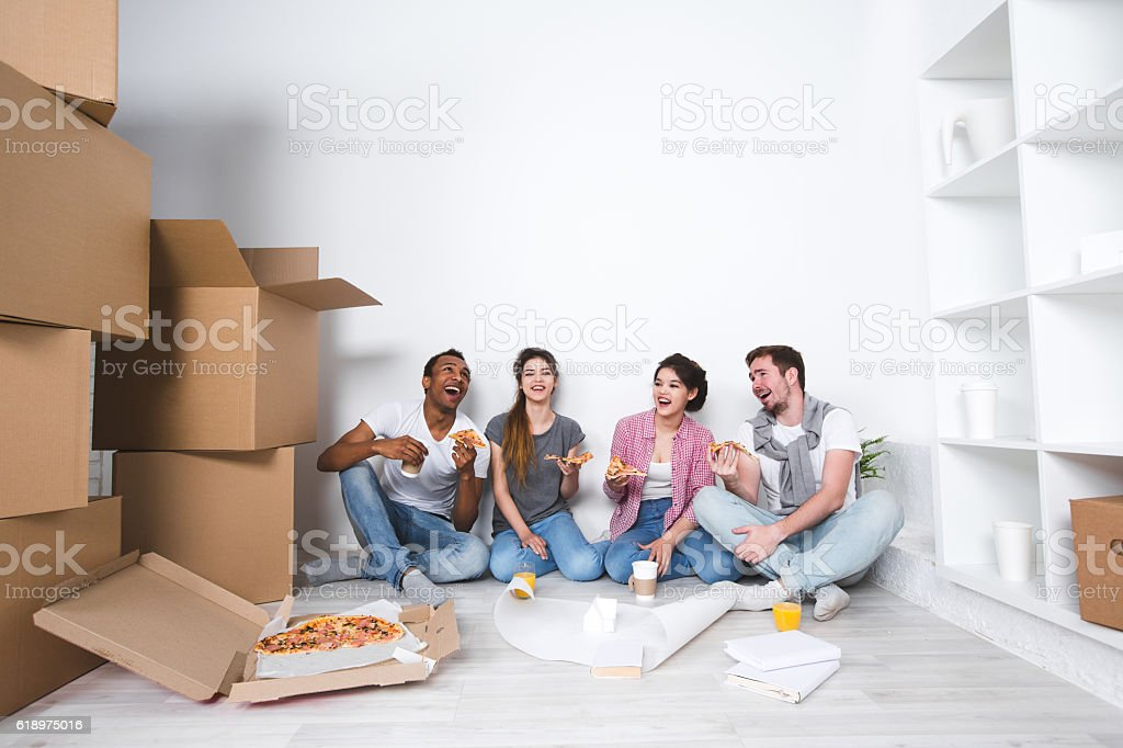 New home. Friends in new apartment after unpacking. stock photo