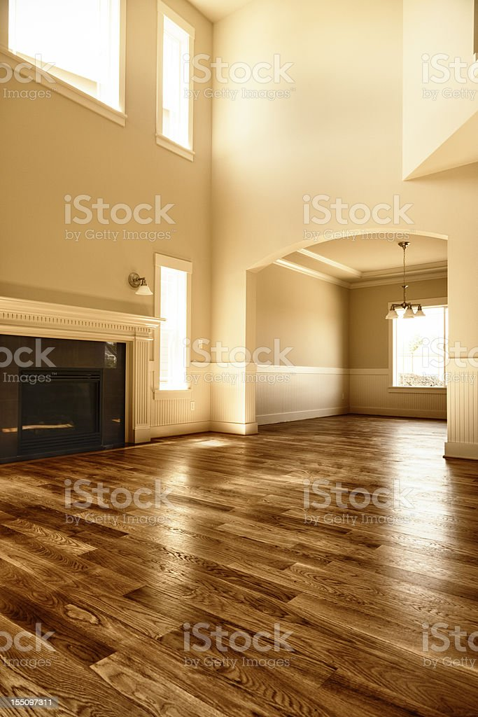 New home interior living room fireplace hardwood floors stock photo