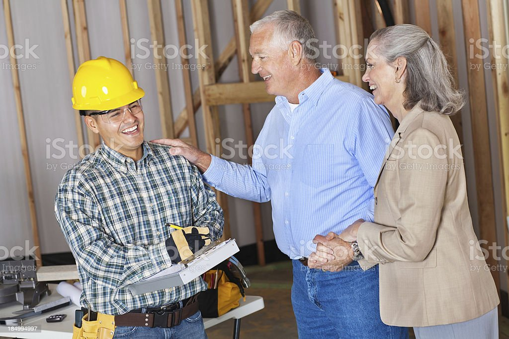 New home owners pleased with builder's progress royalty-free stock photo