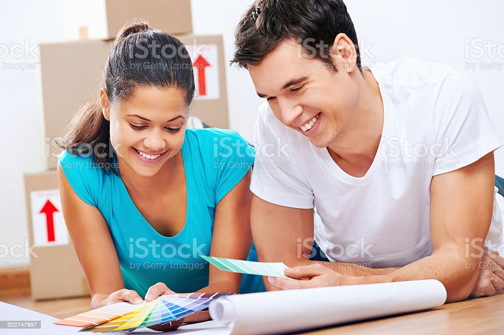 new home plans couple stock photo