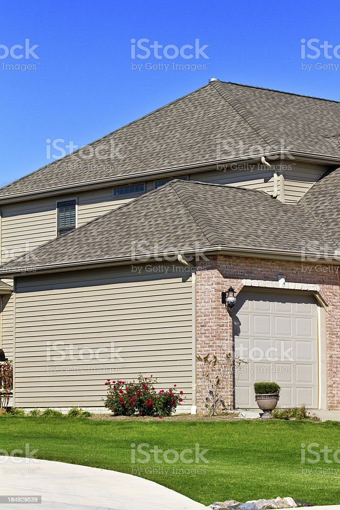 New Home showing vinyl siding, roof and garage stock photo