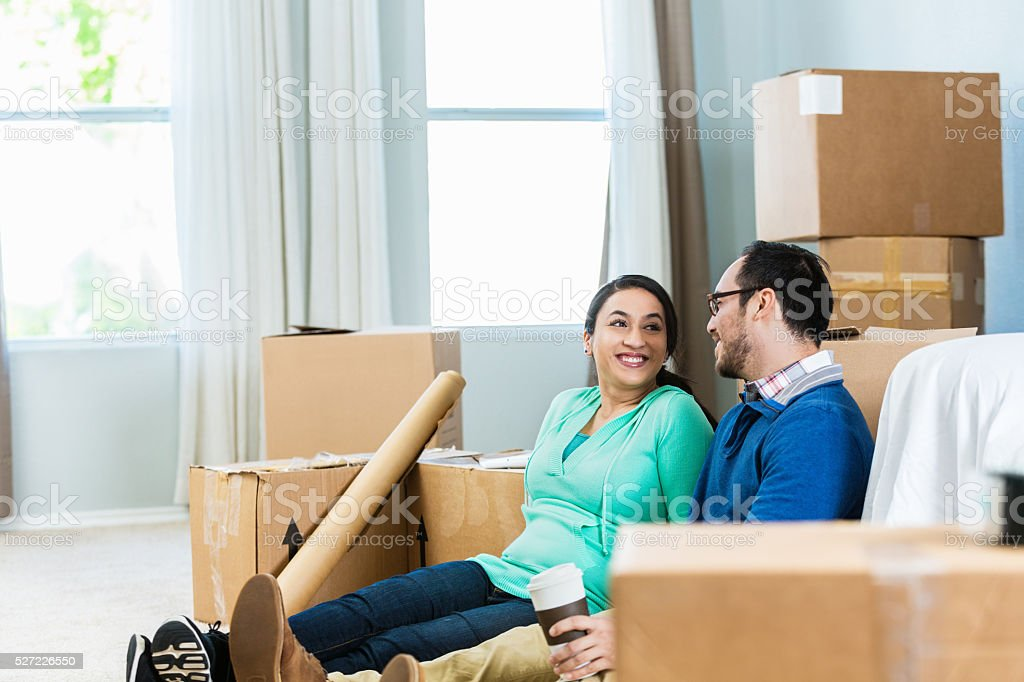 New homeowners relax in their new home stock photo