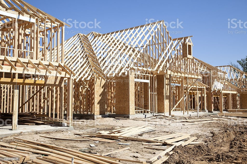 New homes construction site. Framed houses. Lumber. Building. stock photo