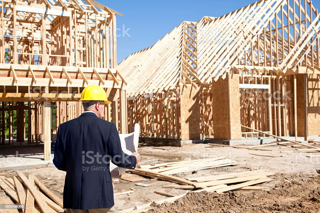 New homes construction site with contractor in foreground stock photo