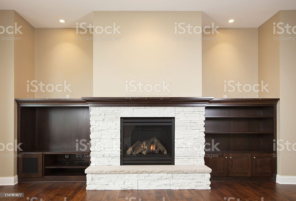 New House Built-in Shelving and Lit Fireplace stock photo