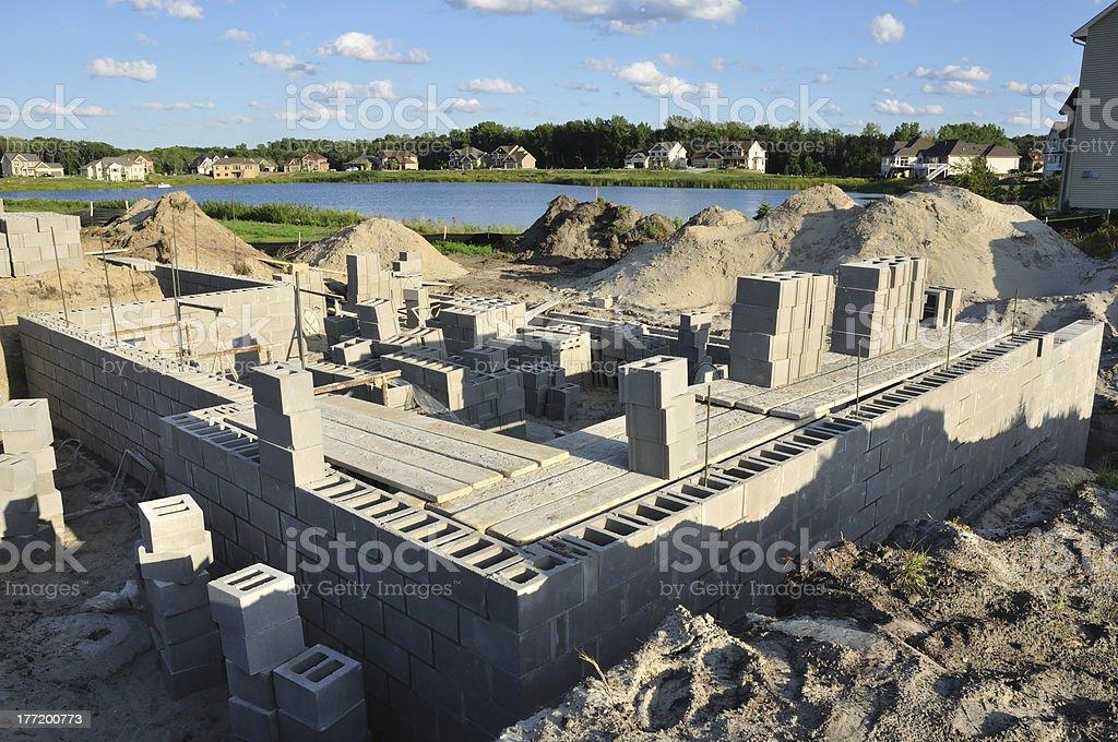 New house construction, building foundation walls using concrete blocks stock photo
