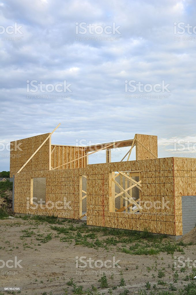 New house construction, framed walls of walk out basement stock photo