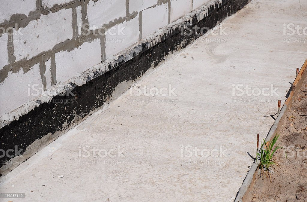 New house construction,foundation waterproofing, vapor barrier stock photo