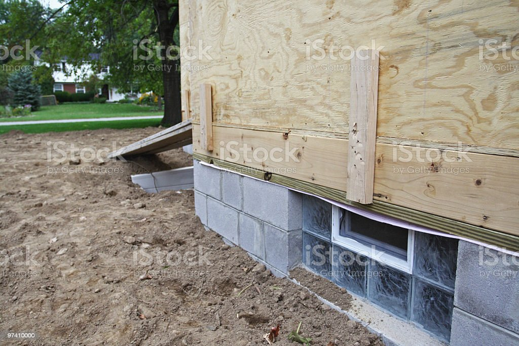 New House Home Residential Construction Basement Glass Block Window stock photo
