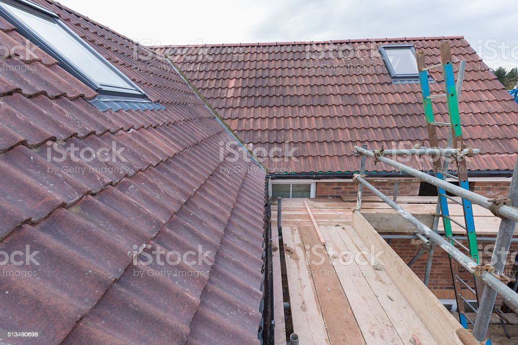 new house roof tiles as fitted at site stock photo
