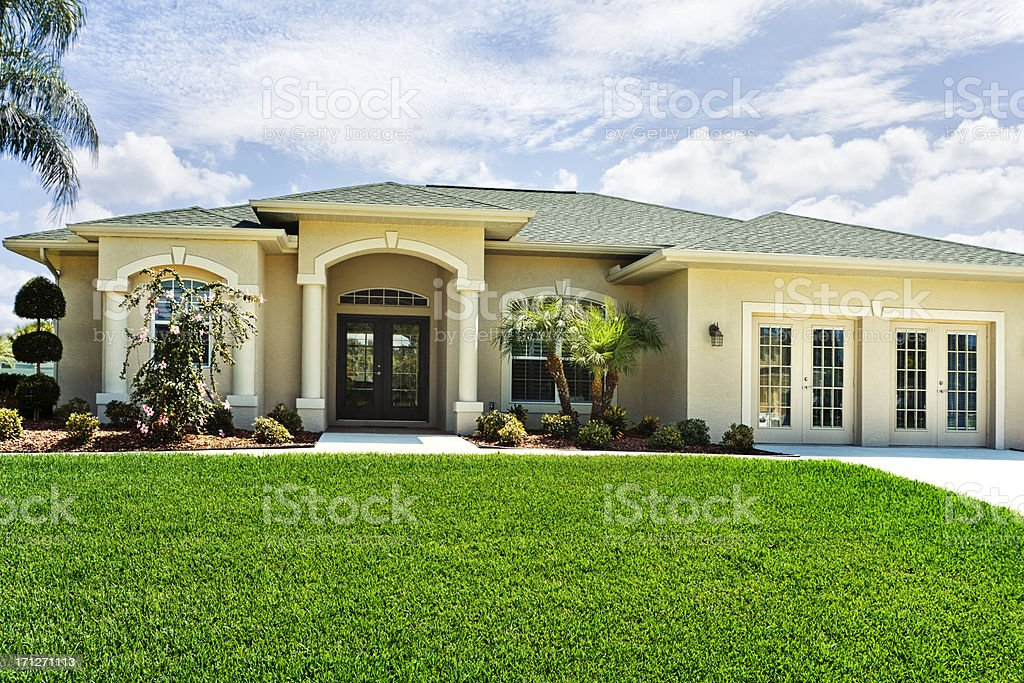 New House with a two car garage sunny beautiful day stock photo