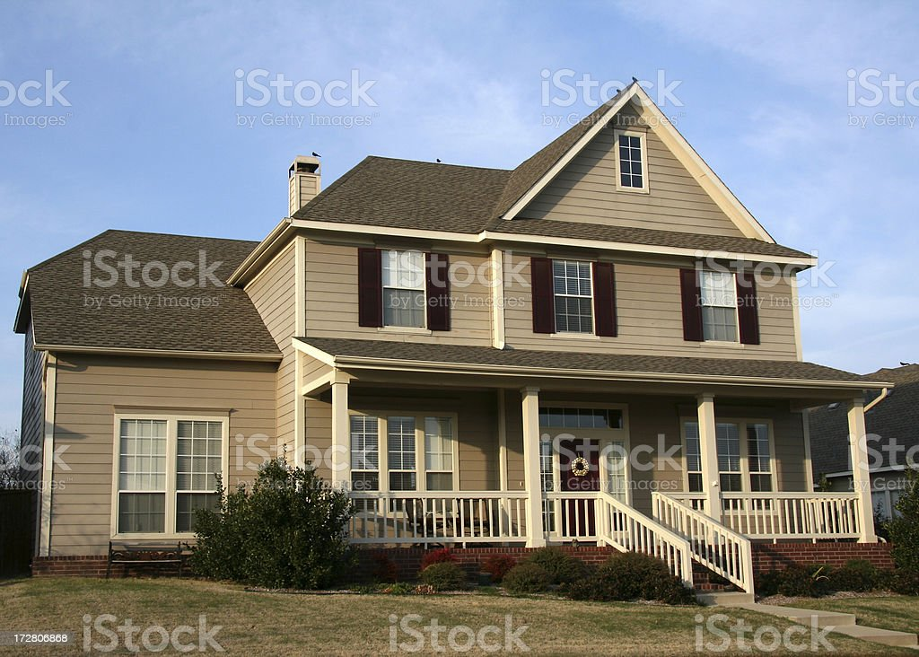 New House With Big Front Porch Under The Blue Sky royalty-free stock photo