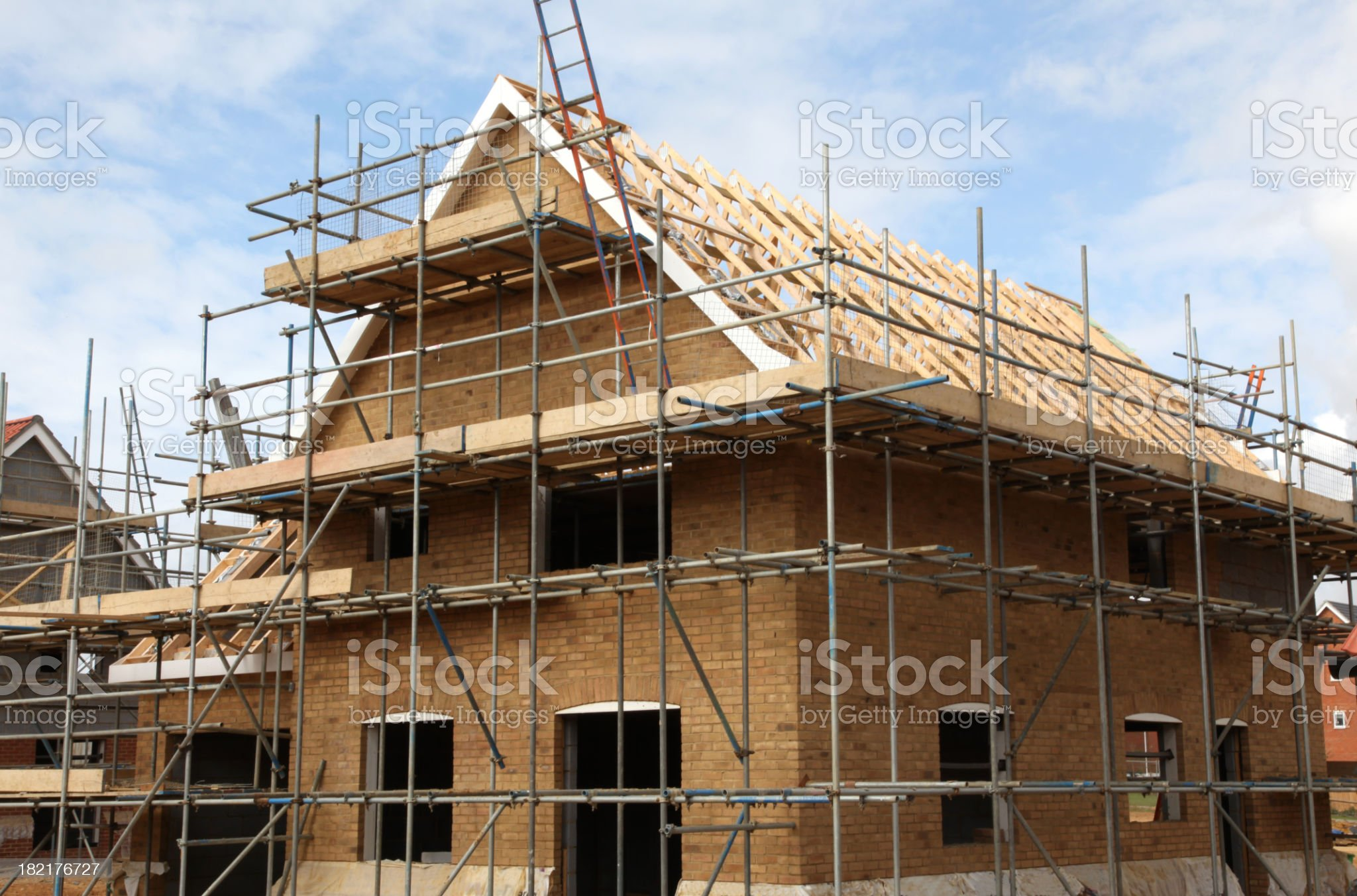 New houses under construction on a building site royalty-free stock photo