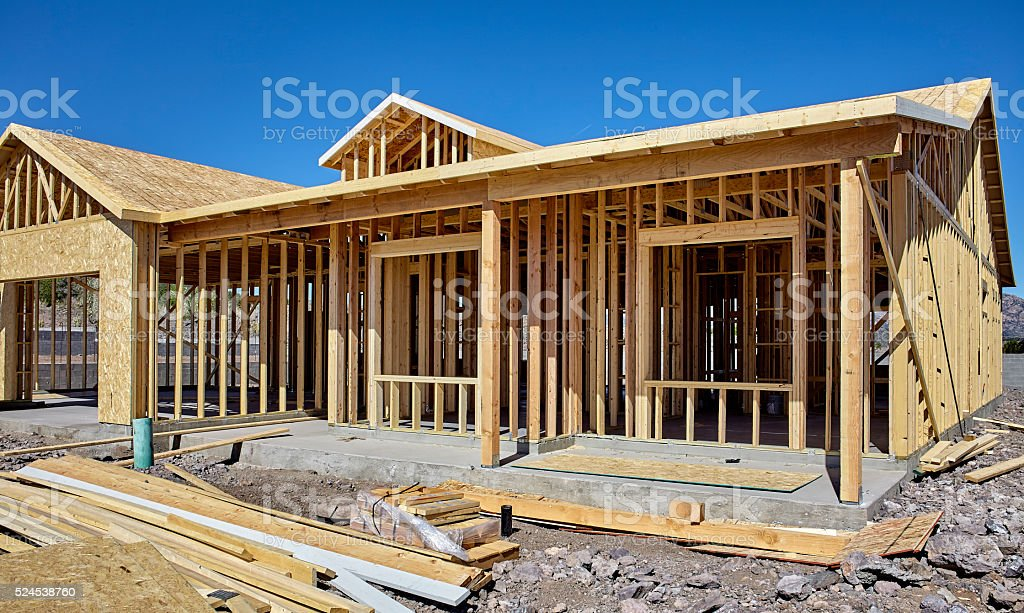 New housing carpentry wood frame construction industry stock photo