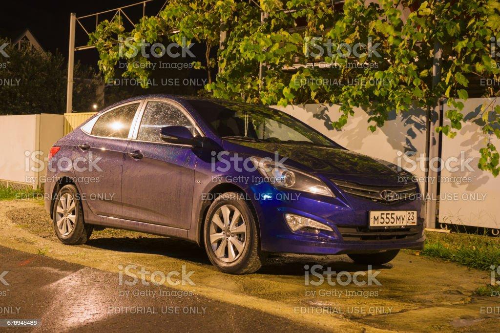 New Hyundai Elantra (Avante) parked on the street at night. stock photo