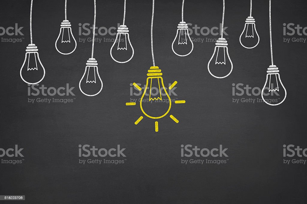 New Idea Light Bulb on Blackboard stock photo