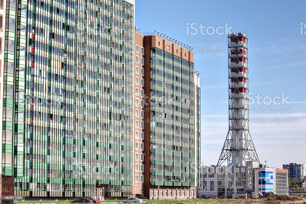 new industrial gas boiler plant, district heating  house chimney stock photo