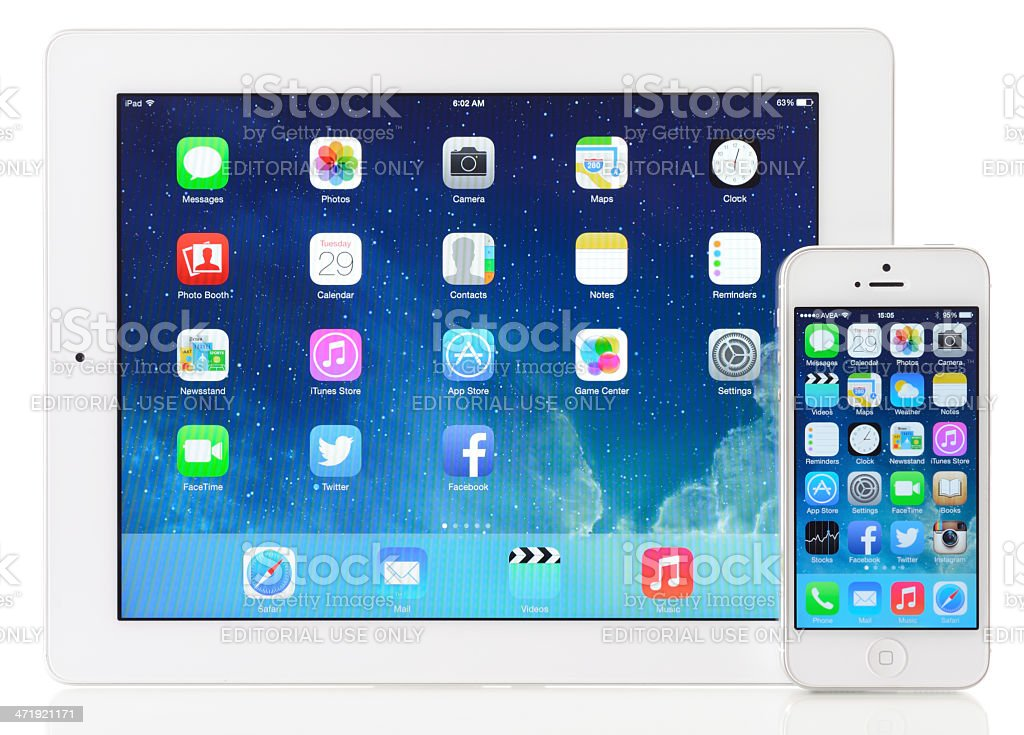 New iOS 7 on Apple iPad 3 & iPhone 5 royalty-free stock photo