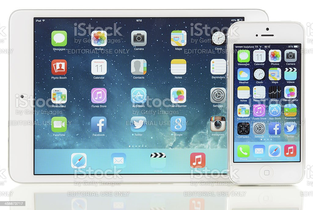 New iOS 7 on iPad Mini and iPhone 5 royalty-free stock photo