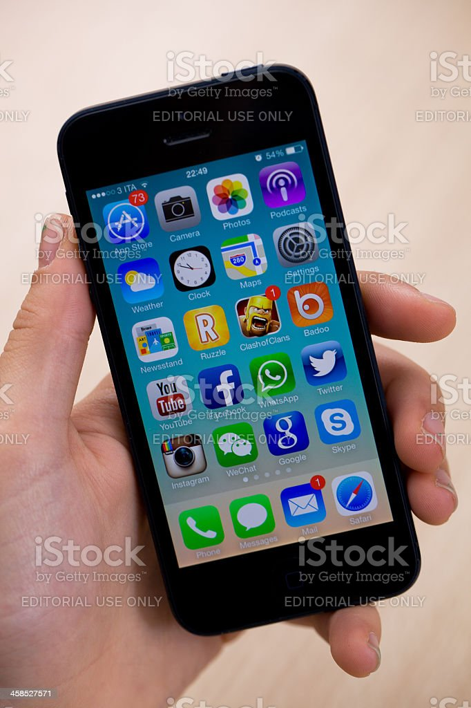 New iOS 7 on iPhone 5 black stock photo