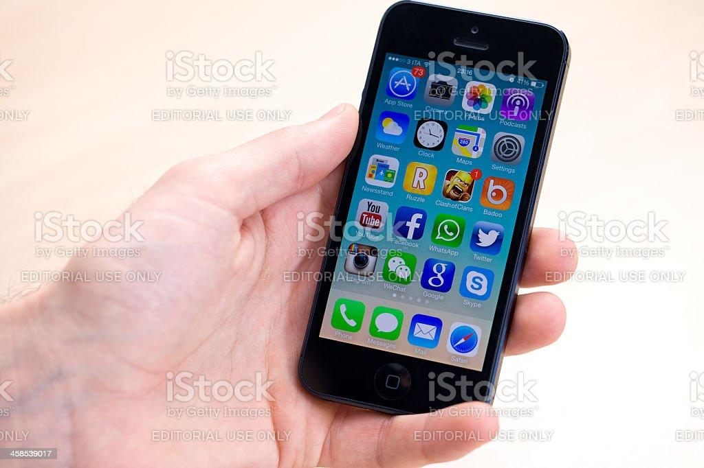 New iOS 7 on iPhone 5 black stock photo
