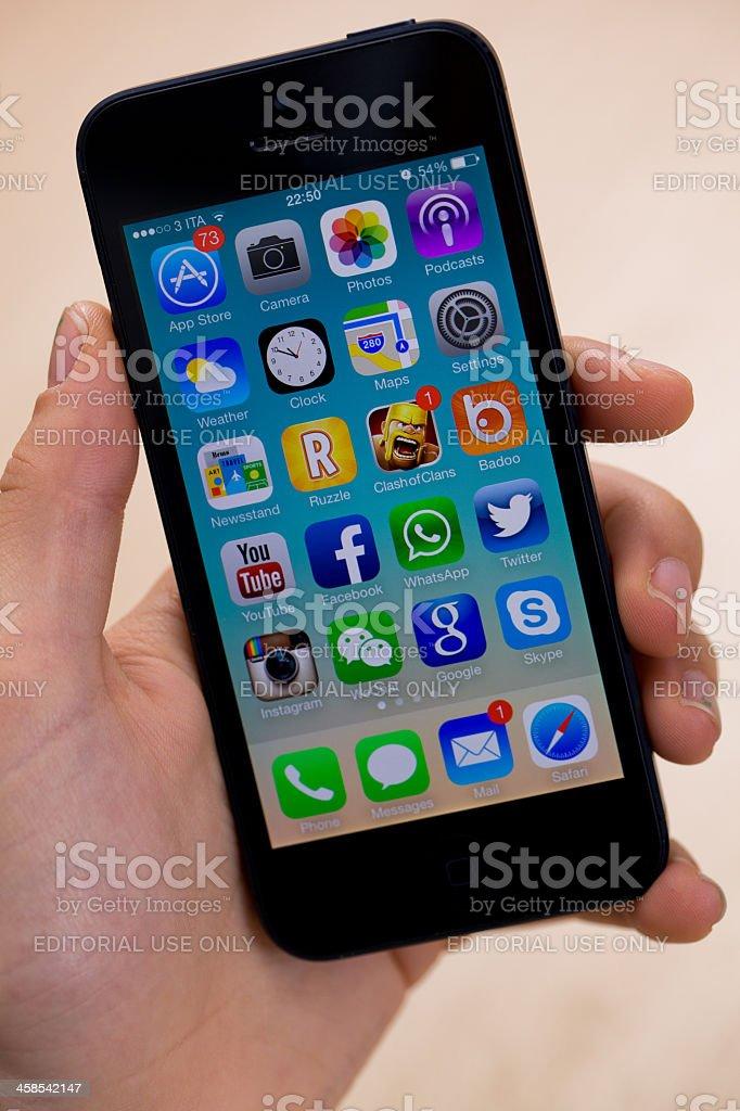 New iOS 7 on iPhone 5 black royalty-free stock photo