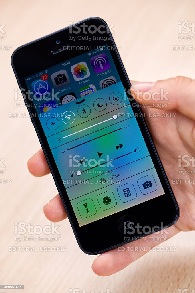 New iOS 7 on iPhone 5 black royalty-free stock photo